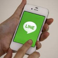 Photo - A smart phone is shown with messaging app Line in Seoul, South Korea, Wednesday, July 16, 2014. Naver Corp. said its subsidiary Line Corp. that operates a popular mobile messaging app is considering listing its shares in Tokyo or New York. Naver, South Korea's largest Internet company, said Wednesday that Line could sell shares in an initial public offering in both Japan and the U.S. (AP Photo/Lee Jin-man)