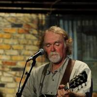 Photo - Checotah singer-songwriter Greg Jacobs performs  in July. Photo provided by Vicki Farmer