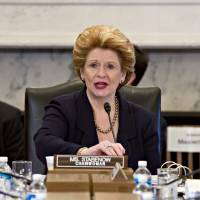 Photo - Senate Agriculture Committee Chair Sen. Debbie Stabenow, D-Mich. speaks on Capitol Hill in Washington, Tuesday, May 14, 2013, during the committee's hearing on the Farm Bill, officially known as the Agriculture Reform, Food, and Jobs Act of 2013. This is the third year in a row that farm-state lawmakers have tried to push the bill through; though it passed the Senate, the House declined to take up the bill last year after conservatives in that chamber objected to the bill's cost and insisted on higher cuts to food stamps.  (AP Photo/J. Scott Applewhite)
