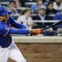 Photo - New York Mets' Wilmer Flores follows through on a two-run single during the second inning of a baseball game against the Chicago Cubs, Saturday, Aug. 16, 2014, in New York. (AP Photo/Frank Franklin II)