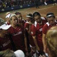 Photo -  UNIVERSITY OF OKLAHOMA / COLLEGE SOFTBALL: The Oklahoma Sooners react after a loss against Alabama in the Women's College World Series softball championship at ASA Hall of Fame Stadium in Oklahoma City, Thursday, June 7, 2012.  Photo by Garett Fisbeck, The Oklahoman