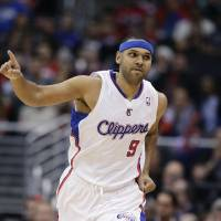 Photo - Los Angeles Clippers' Jared Dudley reacts after making a three-point basket against the San Antonio Spurs during the first half of an NBA basketball game on Monday, Dec. 16, 2013, in Los Angeles. (AP Photo/Jae C. Hong)
