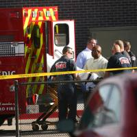 Photo - West Valley City paramedics load a shooting suspect into an ambulance after a shooting at the West Valley City Police department Monday, April 29, 2013 in West Valley City. West Valley City police Sgt. Jason Hauer says 39-year-old James Ramsey Kammeyer entered the lobby around 8:30 a.m. Monday and asked an officer to come out from behind a partition. When several officers came to help, Kammeyer pulled out a gun and at least one of the officers shot him multiple times. His wounds are not life-threatening. (AP Photo/The Deseret News,Chuck Wing)  SALT LAKE TRIBUNE OUT;  MAGS OUT