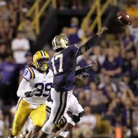 Photo -   In this photo taken Sept. 8, 2012 photo, LSU defensive end Sam Montgomery (99) pressures Washington quarterback Keith Price (17) during the second half of an NCAA college football game in Baton Rouge, La. (AP Photo/Gerald Herbert)
