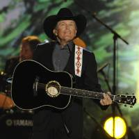 Photo - Singer George Strait performs at the 48th Annual Academy of Country Music Awards at the MGM Grand Garden Arena in Las Vegas on Sunday, April 7, 2013. (Photo by Chris Pizzello/Invision/AP) ORG XMIT: NVPM210