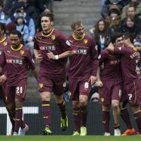 Photo - Watford's Fernando Forestieri, second right, celebrates with teammates after scoring against Manchester City during their English FA Cup fourth round soccer match at The City of Manchester Stadium, Manchester, England, Saturday, Jan. 25, 2014. (AP Photo/Jon Super)
