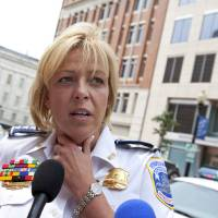 Photo -   FILE - This Aug. 15, 2012 file photo shows Washington Police Chief Cathy Lanier meeting with reporters in Washington. Washington's murder rate was approaching nearly 500 slayings a year in the early 1990s, the annual rate has gradually declined to the point that the city is now on the verge of a once-unthinkable milestone. The number of 2012 killings in the District of Columbia stands at 78 and is on pace to finish lower than 100 for the first time since 1963, police records show. (AP Photo/J. Scott Applewhite, File)