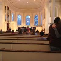 Photo - In this photo taken Sunday, Feb. 3, 2013, mourners embrace as others gathered at Kalamazoo College's Stetson Chapel in Kalamazoo, Mich., to remember Emily Stillman, 19, a sophomore who died that morning due to complications from bacterial meningitis. (AP Photo/Kalamazoo Gazette-MLive Media Group, Emily Monacelli) ALL LOCAL TV OUT; LOCAL TV INTERNET OUT