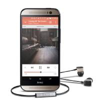 Photo - This product image provided by Harmon Kardon shows the HTC One M8 smartphone and AE-S Premium headphones. The phone features Clari-Fi, a new technology from Harman Kardon, which aims to restore some of the audio signal that is lost because of digital compression in today's download and streaming formats. (AP Photo/Harman-Kardon)