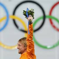 Photo - Gold medallist Michel Mulder of the Netherlands celebrates during the flower ceremony for the men's 500-meter speedskating race at the Adler Arena Skating Center at the 2014 Winter Olympics, Monday, Feb. 10, 2014, in Sochi, Russia. (AP Photo/Patrick Semansky)