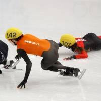 Photo - Valerie Maltais of Canada, right, crashes out as she competes with Jessica Smith of the United States, left, and Jorien ter Mors of the Netherlands, centre, in a women's 1000m short track speedskating semifinal at the Iceberg Skating Palace during the 2014 Winter Olympics, Friday, Feb. 21, 2014, in Sochi, Russia. (AP Photo/Vadim Ghirda)