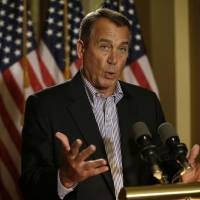 Photo - House Speaker John Boehner of Ohio gestures as he speaks during a news conference on Capitol Hill in Washington, Friday, Dec. 7, 2012, to discuss the pending fiscal cliff.  Boehner said there's been no progress in negotiations on how to avoid the fiscal cliff of tax hikes and spending cuts and called on President Barack Obama to come up with a new offer.  (AP Photo/Pablo Martinez Monsivais)