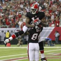 Photo -   Atlanta Falcons wide receiver Roddy White (84) celebrates with Julio Jones (11) after catching a touchdown pass during the first half of an NFL football game against the Carolina Panthers Sunday, Sept. 30, 2012, in Atlanta. (AP Photo/John Bazemore)