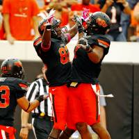 Photo - Oklahoma State's Isaiah Anderson celebrates his touchdown reception with Oklahoma State's Michael Harrison (7)during a college football game between the Oklahoma State University Cowboys (OSU) and the University of Kansas Jayhawks (KU) at Boone Pickens Stadium in Stillwater, Okla., Saturday, Oct. 8, 2011 Photo by Steve Sisney, The Oklahoman