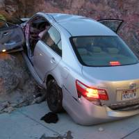 Photo - FILE - In this Nov. 5, 2010 file photo released by the Utah Highway Patrol, a Toyota Camry is shown after it crashed as it exited Interstate 80 in Wendover, Utah. Police suspect problems with the Camry's accelerator or floor mat caused the crash that left two people dead and two others injured. The Wall Street Journal is reporting Wednesday March 19, 2014 the U.S. Justice Department may reach a $ 1 billion settlement with Toyota Motor Corp., ending a four-year criminal investigation into the Japanese automaker's disclosure of safety problems. (AP Photo/Utah Highway Patrol, File)