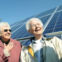 Photo - Sisters Dorothy Diederichs, left, and Eileen Semonin of the Sisters, Servants of the Immaculate Hearts of Mary Motherhouse stand next Detroit Edison's solar arrays behind the IHM in Monroe, Mich., Friday, April 26, 2013. The 518-kilowatt system cost $2.6 million and consists of more than 2,000 photovoltaic modules. It covers three acres and links to the DTE Energy Co. electric grid. (AP Photo/The Monroe Evening News, Tom Hawley)