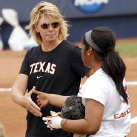 Photo - WOMEN'S COLLEGE WORLD SERIES / COLLEGE SOFTBALL: Connie Clark, coach of University of Texas softball, shakes hand with Karina Scott at practice on May 29, 2013 on the day before the beginning of the Women's College World Series. Photo by KT KING, The Oklahoman KOD