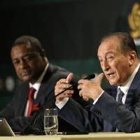 Photo - Eugenio Figueredo, right, president of CONMEBOL, the South American Football Confederation, gestures as he talks  during a news conference as CONCACAF president Jeffrey Webb, left, looks on in Bal Harbour, Fla., Thursday, May 1, 2014. The United States will host the Copa America soccer tournament for the first time in 2016. The Copa America, the world's oldest intercontinental soccer tournament, will celebrate its 100th anniversary in 2016. (AP Photo/Alan Diaz)