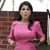 Photo -   FILE - In this Nov. 13, 2012, file photo, Jill Kelley leaves her home in Tampa, Fla. South Korea will revoke an honorary title given to the American socialite tied to the scandal involving former CIA director David Petraeus, officials said Tuesday, Nov. 27, 2012. (AP Photo/Chris O'Meara, File)