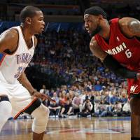 Photo - Miami's LeBron James (6) looks to get the ball past Oklahoma City's Kevin Durant (35) during the NBA basketball game between the Miami Heat and the Oklahoma City Thunder at Chesapeake Energy Arena in Oklahoma City, Sunday, March 25, 2012. Photo by Nate Billings, The Oklahoman