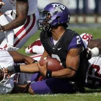 Photo -  Oklahoma's Frank Shannon (20) and Stacy McGee (92) combine to bring down TCU's Trevone Boykin (2) at Amon G. Carter Stadium in Fort Worth, Texas, on Saturday, Dec. 1, 2012. Photo by Steve Sisney, The Oklahoman