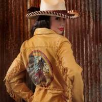 Photo -  Double D Ranchwear deerskin jacket, Patricia Wolfe hat and Habitual jeans from Filigree. Model is Adrianna. Photo by Chris Landsberger, The Oklahoman