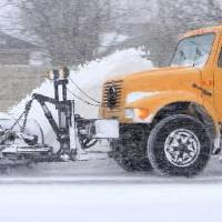 Photo - A snow plow moves along the NW Expressway in Oklahoma City Tuesday, Feb. 1, 2011. Photo by Paul B. Southerland