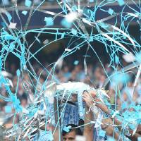 Photo - Manchester City's Sergio Aguero celebrates with the Premier League Trophy after his team's 2-0 win against West Ham in their English Premier League soccer match at the Etihad Stadium in Manchester, England, Sunday May 11, 2014. (AP Photo/Lynne Cameron, PA Wire)    UNITED KINGDOM OUT   -   NO SALES   -   NO ARCHIVES