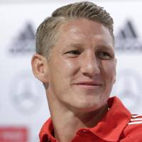 Photo - German national soccer player Bastian Schweinsteiger attends a news conference in Santo Andre near Porto Seguro, Brazil, Sunday, July 6, 2014. Germany faces Brazil on upcoming Tuesday in Mineirao Stadium in Belo Horizonte, in the semifinals of the World Cup. (AP Photo/Matthias Schrader)