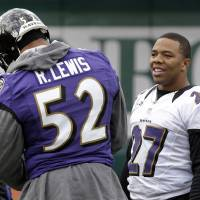 Photo - Baltimore Ravens running back Ray Rice, right, chats with linebacker Ray Lewis before warming up at an NFL Super Bowl XLVII football practice on Wednesday, Jan. 30, 2013, in New Orleans. The Ravens face the San Francisco 49ers in Super Bowl XLVII on Sunday, Feb. 3. (AP Photo/Patrick Semansky)