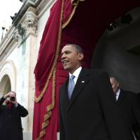 Photo - President Barack Obama arrives on the West Front of the Capitol in Washington, Monday, Jan. 21, 2013, for  his ceremonial swearing-in ceremony during the 57th Presidential Inauguration.  (AP Photo/Win McNamee, Pool)