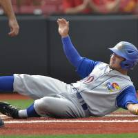 Photo - Kansas' Justin Protacio slides into home to score a run in the second inning of an NCAA college baseball regional tournament game against Kentucky in Louisville, Ky., Friday, May 30, 2014. (AP Photo/Timothy D. Easley)