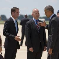 Photo - President Barack Obama shakes hands with Delaware Attorney General Beau Biden, left, next to Biden's wife Hallie Biden, far left, and Delaware Gov. Jack Markell as he arrives at New Castle Air National Guard Base in New Castle, Del., Thursday, July 17, 2014, en route to Wilmington where he is expected to visit the site of the damaged I-495 bridge in Wilmington to speak about transportation and infrastructure. (AP Photo/Jacquelyn Martin)