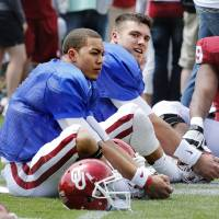 Photo - Kendal Thompson, left, and Blake Bell warm up before the annual Spring Football Game at Gaylord Family-Oklahoma Memorial Stadium in Norman, Okla., on Saturday, April 13, 2013. Photo by Steve Sisney, The Oklahoman