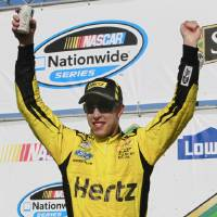 Photo - Brad Keselowski celebrates after winning the NASCAR Nationwide Series auto race at New Hampshire Motor Speedway Saturday, July 12, 2014, in Loudon, N.H. (AP Photo/Jim Cole)