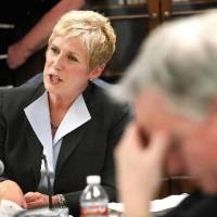 Photo - State Superintendent Janet Barresi. left, conducted the first meeting of the state board of education since she assumed her post earlier this month. The meeting, in the Ralph Hodges Building, near the state Capitol, on Thursday, January 27, 2011, became contentious at times as board members, including Tim Gilpin, at right, and Barresi exchanged verbal barbs as to how the business of the board and the superintendent's office should be run. Photo by Jim Beckel