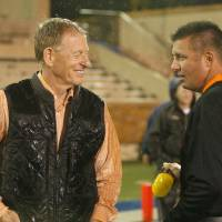 Photo - WEATHER DELAY: Oklahoma State's Mike Holder and head coach Mike Gundy talk on the field during rain delay at a college football game between the Oklahoma State University Cowboys (OSU) and the University of Tulsa Golden Hurricane (TU) at H.A. Chapman Stadium in Tulsa, Okla., Saturday, Sept. 17, 2011. Photo by Sarah Phipps, The Oklahoman  ORG XMIT: KOD