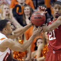 Photo - Oklahoma's Cameron Clark (21) and Oklahoma State's Darrell Williams (25) fight for a loose ball during the Bedlam men's college basketball game between the University of Oklahoma Sooners and Oklahoma State University Cowboys at Gallagher-Iba Arena in Stillwater, Okla., Saturday, February, 5, 2011. Photo by Sarah Phipps, The Oklahoman