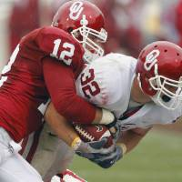Photo - COLLEGE FOOTBALL / RED AND WHITE SPRING GAME: Marshall Musil (32) is tackled by Austin Box (12) during the spring Red and White football game for the University of Oklahoma (OU) Sooners at Gaylord Family -- Oklahoma Memorial Stadium on Saturday, April 17, 2010, in Norman, Okla.  Photo by Steve Sisney, The Oklahoman ORG XMIT: KOD