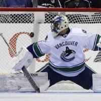 Photo - Vancouver Canucks goalie Roberto Luongo blocks a shot against the Los Angeles Kings during the first period of an NHL Hockey game in Los Angeles, Monday, Jan. 28, 2013. (AP Photo/Chris Carlson)
