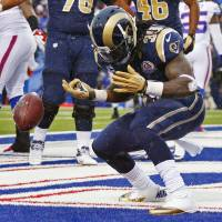 Photo - St. Louis Rams' Steven Jackson reacts after scoring a touchdown during the second half of an NFL football game against the Buffalo Bills, Sunday, Dec. 9, 2012, in Orchard Park, N.Y. (AP Photo/Bill Wippert)