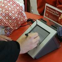Photo - FILE - In this Jan. 18, 2008 file photo, a customer signs his credit card receipt at a Target store in Tallahassee, Fla. Target says that about 40 million credit and debit card accounts customers may have been affected by a data breach that occurred at its U.S. stores between Nov. 27, 2013, and Dec. 15, 2013. (AP Photo/Phil Coale, File)