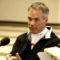 Photo - OSU defensive coordinator Tim Beckman answers a question during the weekly Oklahoma State University (OSU) college football press conference at Boone Pickens Stadium in Stillwater, Okla., Monday, September 17, 2007. BY MATT STRASEN, THE OKLAHOMAN ORG XMIT: KOD