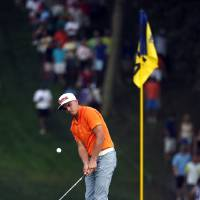 Photo - Rickie Fowler chips to 12th hole during the final round of the PGA Championship golf tournament at Valhalla Golf Club on Sunday, Aug. 10, 2014, in Louisville, Ky. (AP Photo/Mike Groll)