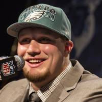 Photo - Lane Johnson, from Oklahoma, speaks during a news conference after being selected fourth overall by the Philadelphia Eagles during the first round of the NFL football draft, Thursday, April 25, 2013, at Radio City Music Hall in New York. (AP Photo/Craig Ruttle) ORG XMIT: NYCR120