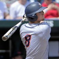 Photo - Virginia's Robbie Coman (8) follows through with a two-run single against Mississippi in the fourth inning of an NCAA College World Series baseball game in Omaha, Neb., Saturday, June 21, 2014. (AP Photo/Ted Kirk)