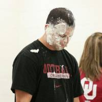 Photo - Heritage Trails Elementary School Principal Jason Perez reacts after getting a pie in the face courtesy of Jason White during an assembly Wednesday at the school. PHOTO BY PAUL SOUTHERLAND, THE OKLAHOMAN  PAUL B. SOUTHERLAND - PAUL B. SOUTHERLAND