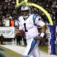 Photo -   Carolina Panthers quarterback Cam Newton celebrates after throwing a touchdown pass in the first half of an NFL football game against the Philadelphia Eagles, Monday, Nov. 26, 2012, in Philadelphia. (AP Photo/Mel Evans)