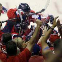 Photo - The Washington Capitals and fans celebrate the game-winning goal by center Mike Ribeiro in overtime of Game 5 first-round NHL Stanley Cup playoff hockey series against the New York Rangers, Friday, May 10, 2013, in Washington. The Capitals won 2-1, in overtime. (AP Photo/Alex Brandon)