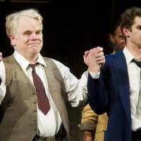 Photo -   FILE - In this March 15, 2012 file photo, actors Philip Seymour Hoffman, left, and Andrew Garfield appear at the curtain call for the opening night performance of the Broadway revival of Arthur Miller's